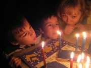 Kids in menorah light